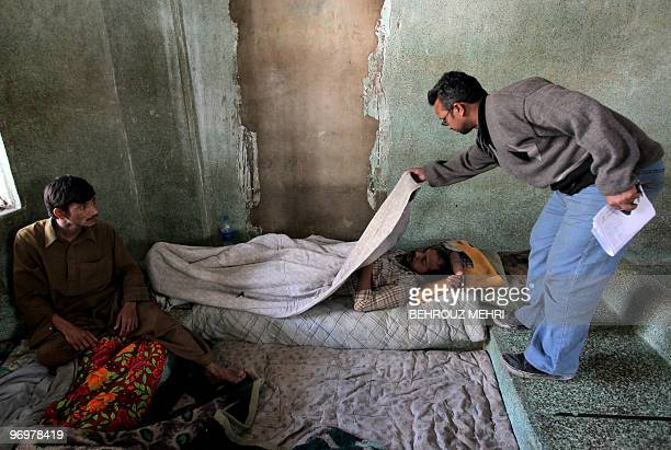 Pakistani man Asghar Ali uncle of missing mentally challenged twenty year old Muhammed Bagher searches for his nephew at a rehabilitation center for...
