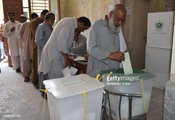 A Pakistani man casts his vote at a polling station during Pakistan's general election in Quetta on July 25 2018 Pakistanis voted July 25 in...