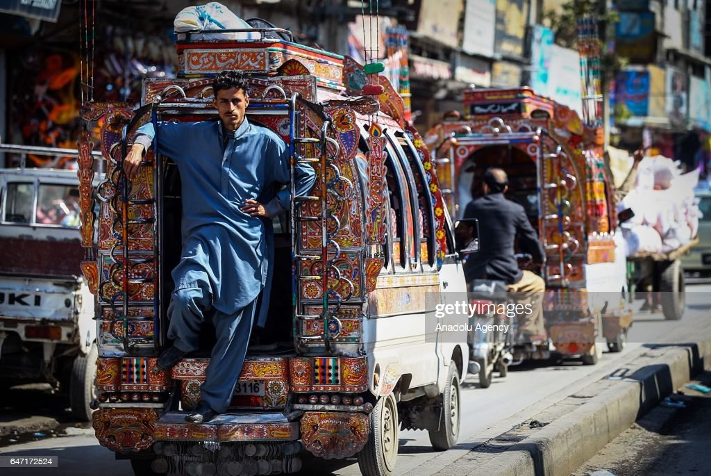 Pakistani man is seen on a colorful bus at Raja market place where Pakistani people prefer shopping due to it's reasonable prices in Rawalpindi...