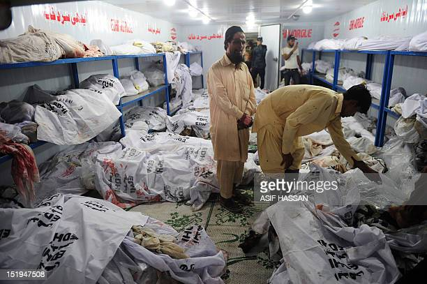 A Pakistani man mourns as he stands in the EDHI Morgue to identify his relatives who were killed in a garment factory fire in Karachi on September 13...