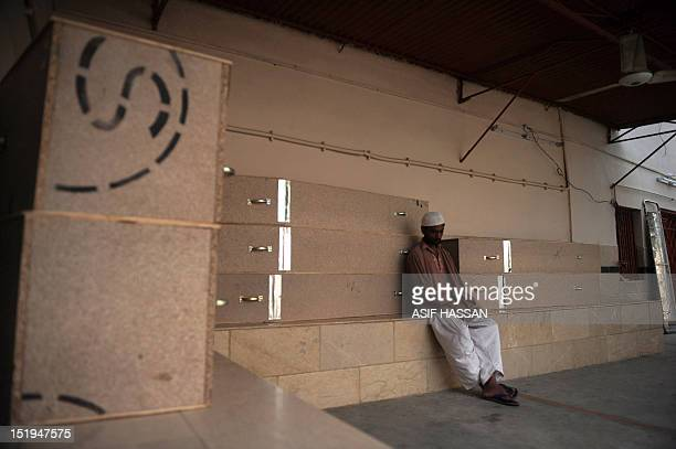 A Pakistani man mourns as he waits at the EDHI Morgue to identify his relative who was killed in a garment factory fire in Karachi on September 13...