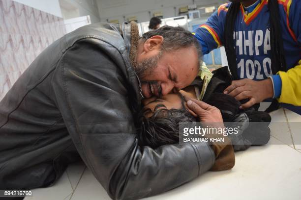 Pakistani man mourns the death of relative in a hospital after suicide bombers attacked a Methodist church during a Sunday service in Quetta on...