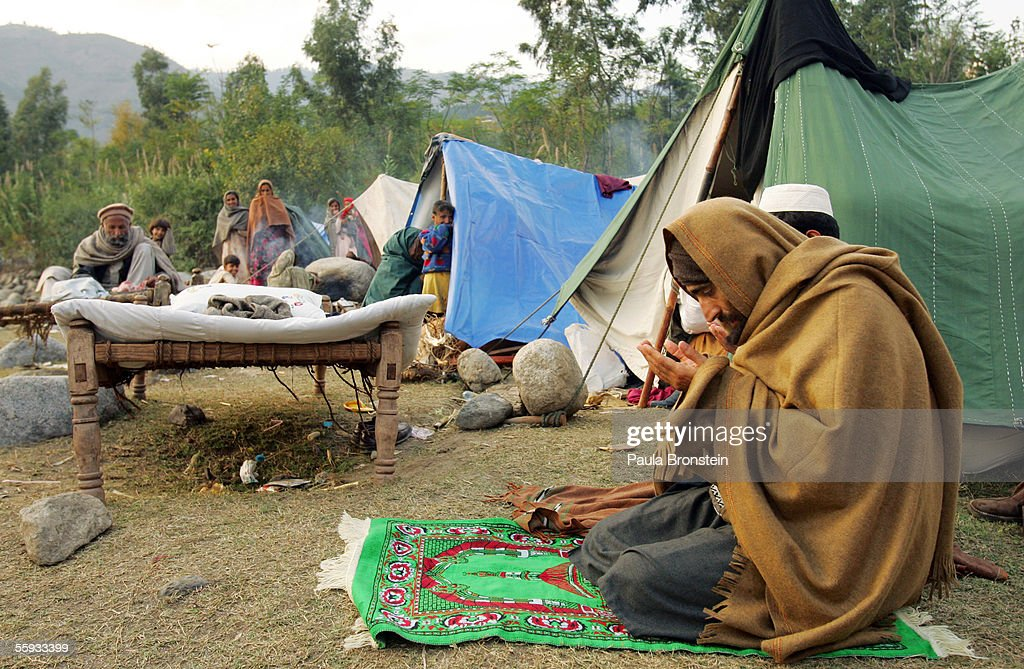 Pakistani man prays in a tent city October 16 2005 in Balakot Pakistan It is estimated & Recovery Quake Earthquake Relief Aid 55922206 Stock Photos and ...