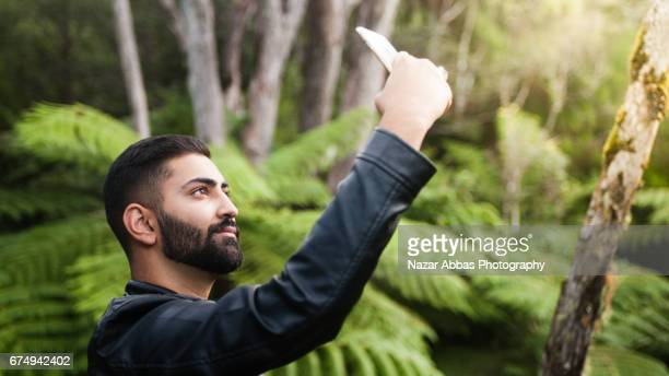 pakistani man taking selfie. - handsome pakistani men stock photos and pictures