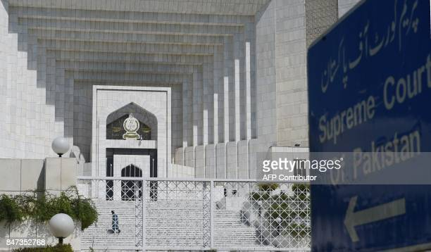 A Pakistani man walks by the Supreme Court building in Islamabad on September 15 2017 Pakistan's Supreme Court on September 15 dismissed an appeal...
