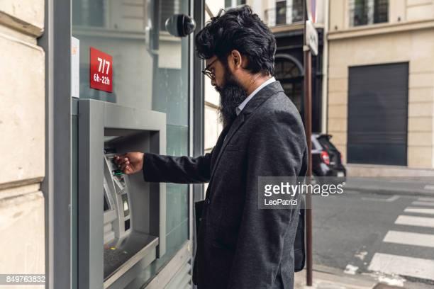 Pakistani man withdrawal at ATM in Paris