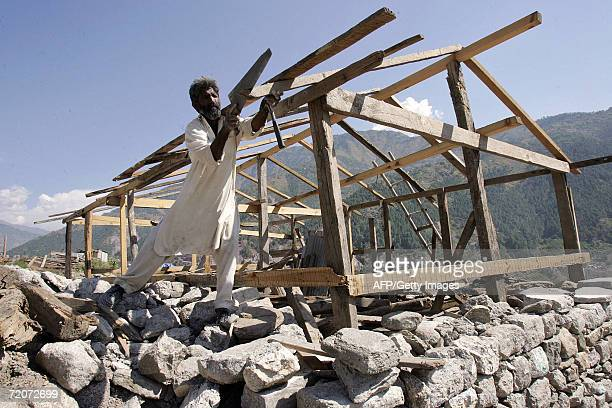 Pakistani man works on a wood shelter near a mosque which collapsed in the 08 October 2005 earthquake in Balakot in the North West Frontier Province...
