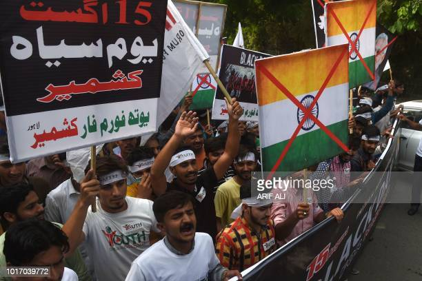 Pakistani march in an antiIndian rally in Lahore on August 15 as they observe 'Black Day' on the Indian Independence Day Pakistani protestors are...