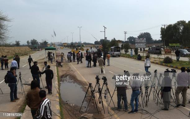 Pakistani media gather near the India and Pakistan border on the Pakistani side of the Wagah border on March 1 2019 Pakistan was set to free a...