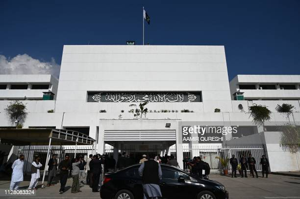 Pakistani media personnel gather outside the Parliament building during a joint session in Islamabad on February 28 2019 Pakistan said on February 28...