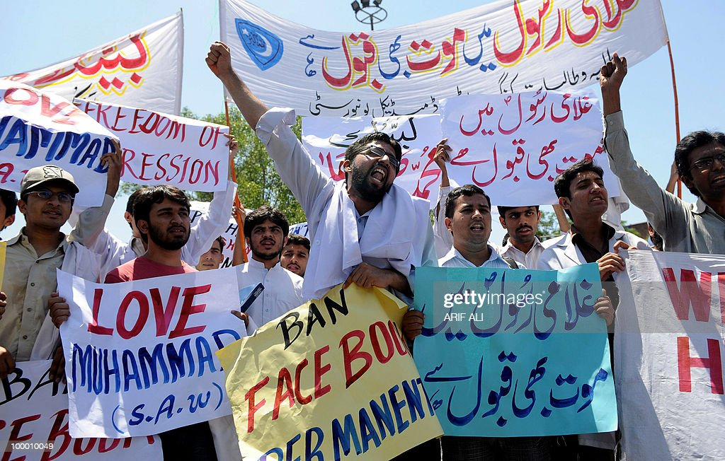 Pakistani medical students shout slogans during a protest in Lahore on May 20, 2010, against the published caricatures of Prophet Mohammed on Facebook. Pakistan 'strongly condemned' caricatures of the Prophet Mohammed that appeared on social networking website Facebook as insulting to Muslims worldwide. The Pakistan Telecommunications Authority (PTA) blocked access to Facebook and YouTube in a growing row sparked when a private Facebook user asked people to send in drawings of the Prophet Mohammed.