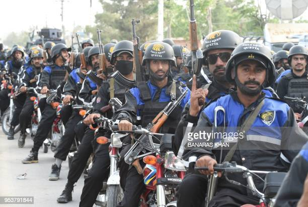 Pakistani members of new police force the 'Eagle Squad' patrol along a street in Quetta on May 2 2018 Islamist militants and separatist groups have...