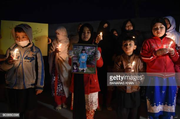 Pakistani members of the Hazara community hold a vigil in tribute to Zainab who was raped and murdered in the city of Kasur in Punjab province in...