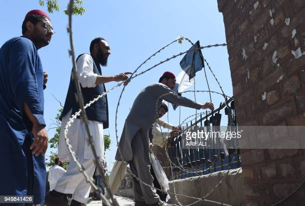 Pakistani members of the Pashtun Protection Movement and student activists cordon an area with barbed wire before the start of demonstration in...