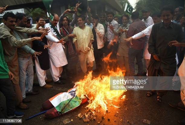 Pakistani members of the Sindh Medical Staff Association burn an effigy of Indian Prime Minister Narendra Modi during an antiIndian protest in...
