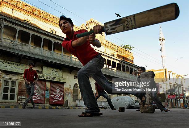 Pakistani men and boys play tapeball cricket in the streets of Rawalpindi on August 9 2011 in Rawalpindi Pakistan Although test cricket has been...
