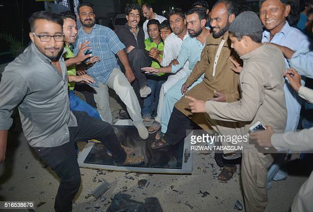 Pakistani men broke a TV set after their cricket team lost a match against India during the World T20 cricket tournament on March 19 2016 in Karachi...