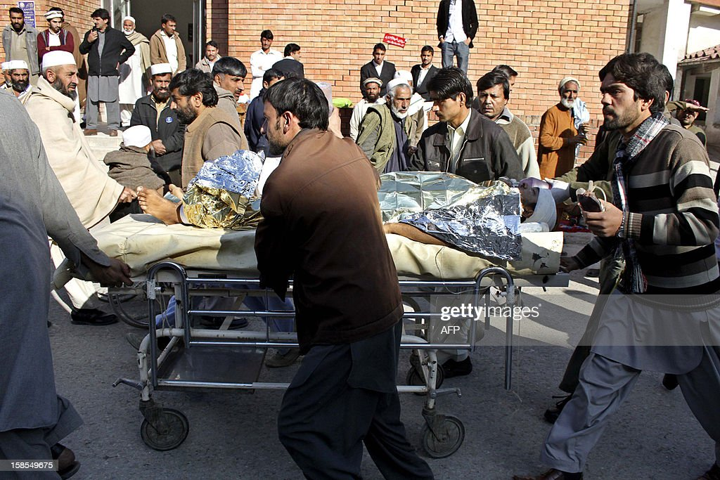 Pakistani men carry a critical injured polio vaccination worker on a stretcher to a hospital following an attack by gunmen in Peshawar on December 19, 2012. Gunmen killed three people working on a polio vaccination campaign in Pakistan on December 19, officials said, as the nationwide drive against the crippling disease suffered a third day of bloodshed.