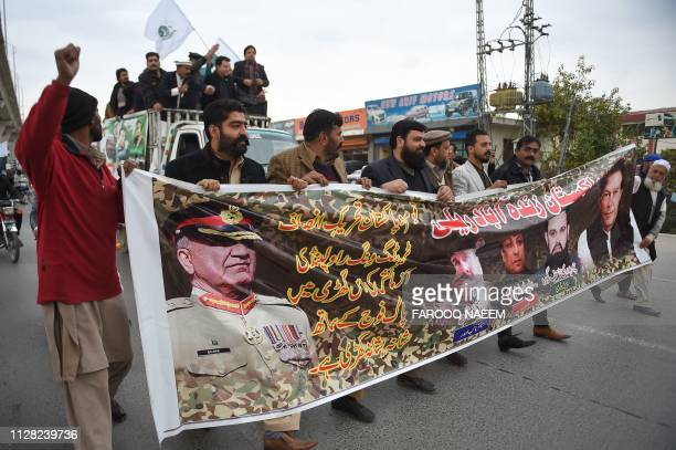 Pakistani men march in support of the Pakistan army during an antiIndia protest in Rawalpindi on March 1 2019 Pakistan was set to free a captured...