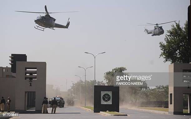 Pakistani military helicopters fly over the area of an attack on the entrance of army headquarters in the garrison city Rawalpindi on October 10 2009...