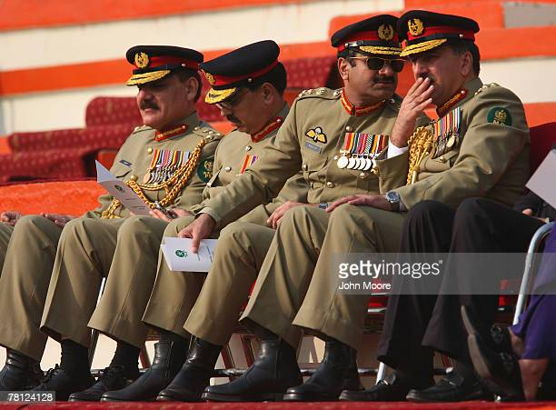 Pakistani military officers watch as President Pervez Musharraf hands over power to the new army chief Gen Ashfaq Kayani at a change of command...