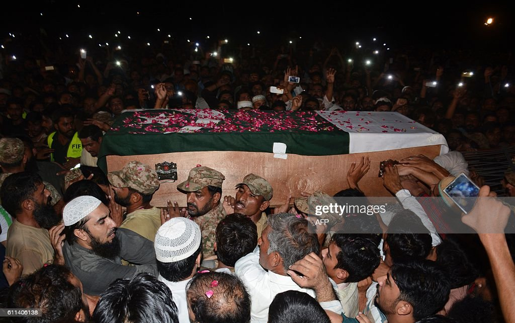 Pakistani military officials relatives and residents carry the coffin of a Pakistani soldier killed in firing along the Line of Control that divides..