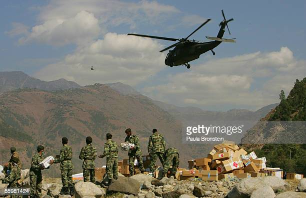 Pakistani military sorts out foreign aid that has been dropped off by a helicopter in the devastated town of Balakot 90% destroyed by the earthquake...