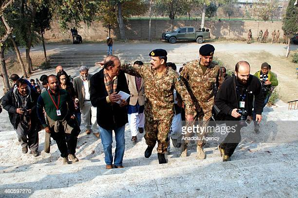 Pakistani military spokesman Major General Asim Bajwa visits an armyrun school which was stormed by Taliban gunmen in Peshawar Pakistan with press...