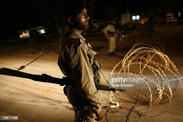 Pakistani military stand guard near the Red Mosque in Islamabad on July 10 2007 after a bloody siege that killed the rebel leader Abdul Rashid Ghazi...
