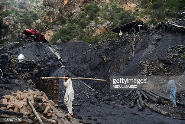 Pakistani miners fix a collapsed coal mine in Akhurwal village in Darra Adam Khel town on September 12 2018 Nine miners were killed and four injured...