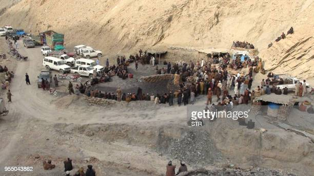 Pakistani miners gather outside the collapsed mine in Marwaarh area 45 kilometres east of Quetta the capital of oil and gasrich Balochistan province...