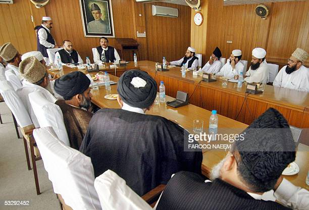 Pakistani Minister for Religious Affairs IjazulHaq speaks with leaders of an alliance of Pakistani Islamic schools during a meeting in Islamabad 27...