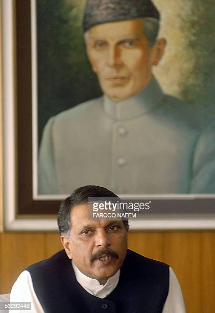 Pakistani Minister for Religious Affairs IjazulHaq speaks with unseen leaders of an alliance of Pakistani Islamic schools during a meeting in...