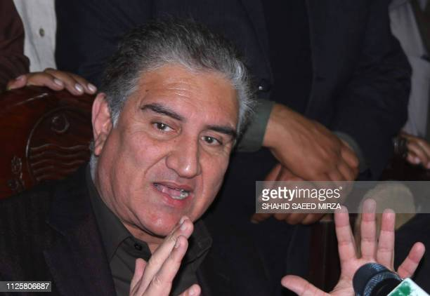 Pakistani Minister of Foreign Affairs Shah Mehmood Qureshi speaks during a press conference in Multan on February 19 following the ongoing tensions...