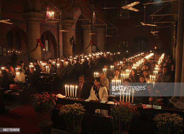 Pakistani Minority Christians gather at Cathedral Church for a candle light during a preChristmas Sunday service to pray for the victims of the...