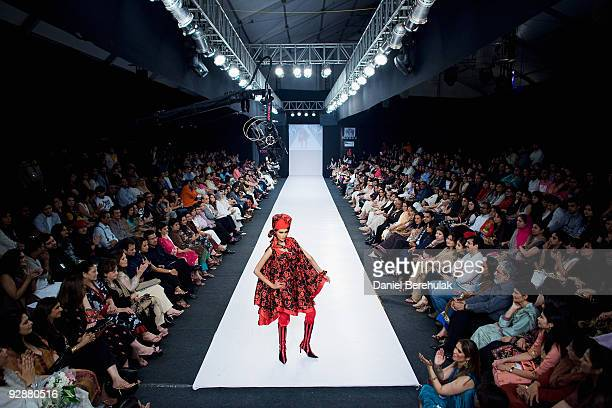 Pakistani model Mehreen Syed wearing a creation by Pakistani designer Adnan Perdesy takes to the catwalk during the 4th day of Fashion Pakistan Week...