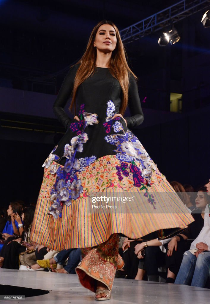 Pakistani model presents a creation by a famous fashion designer ALI XEESHAN on the last day of Pakistan Fashion Design Council Sunsilk Fashion Week..