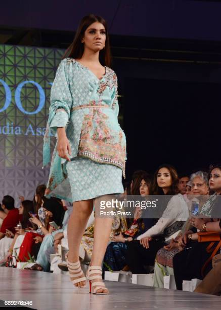Pakistani model presents a creation by a famous fashion designer NOOR on the last day of Pakistan Fashion Design Council Sunsilk Fashion Week in...