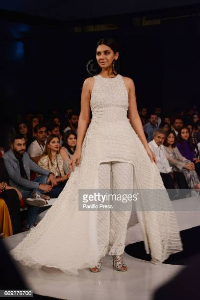 Pakistani model presents a creation by a famous fashion designer KHAADI KHAAS on the last day of Pakistan Fashion Design Council Sunsilk Fashion Week...