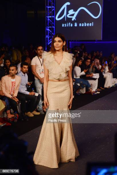 Pakistani model presents a creation by a famous fashion designer ASIFA NABEEL on the last day of Pakistan Fashion Design Council Sunsilk Fashion Week...