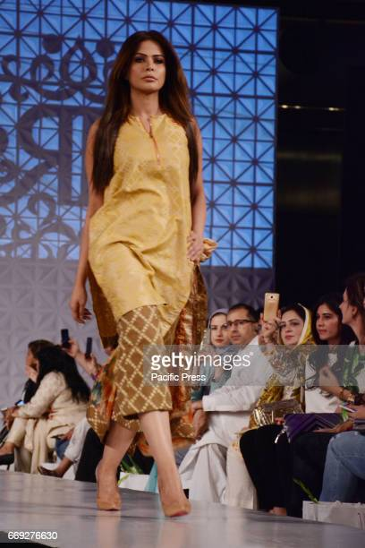 Pakistani model presents a creation by a famous fashion designer RANG RASSIA on the last day of Pakistan Fashion Design Council Sunsilk Fashion Week...