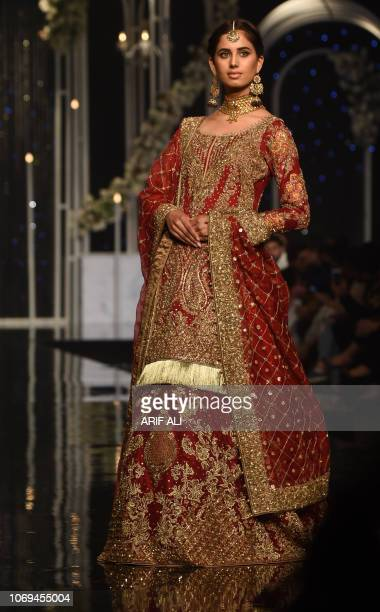 A Pakistani model presents a creation by designer Aisha Imran during the Pantene Hum Bridal Couture Week in Lahore on December 7 2018