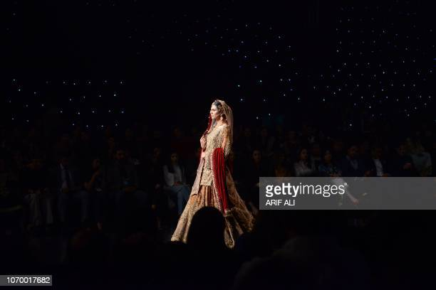 A Pakistani model presents a creation by designer Faika Karim during the Pantene Hum Bridal Couture Week in Lahore on December 8 2018