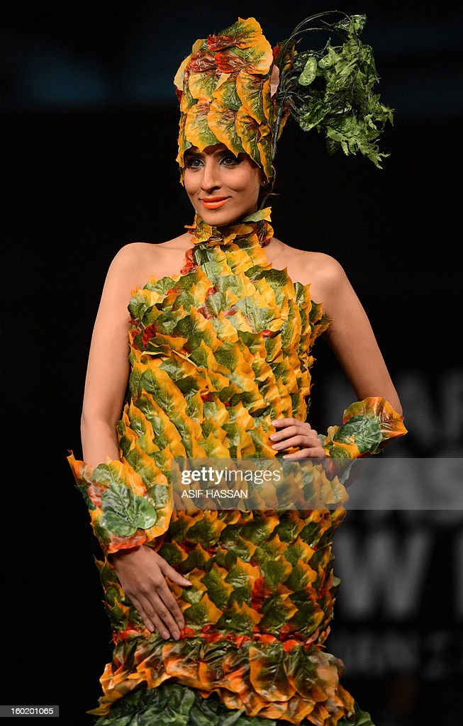 A Pakistani model presents a creation by Nigerian fashion designer Bayo Adegbe of Modela Couture on the 1st day of Karachi Fashion Week in Karachi on January 27, 2013. Thirty designers from Pakistan, India, Nigeria United State among others exhibited their vibrant and chic collection as the Karachi Fashion Week (KFW) 4th edition begins in Pakistan's commercial and style capital.