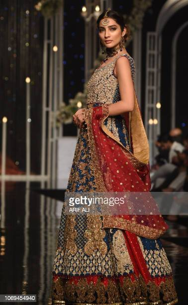 A Pakistani model presents a creation bydesigner Aisha Imran during the Pantene Hum Bridal Couture Week in Lahore on December 7 2018