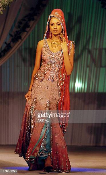 A Pakistani model showcases a creation during a fashion show in Lahore late 31 October 2007 Some 14 designers participated in the fashion show...