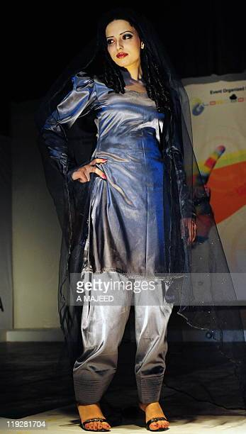 A Pakistani model walks on the podium during a fashion show in Peshawar on July 16 2011 A twoday Fashion Show started on July 16 to showcase...