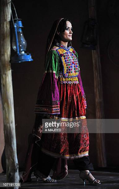 A Pakistani model walks wearing traditional dress during a fashion show at a cultural Festival in Peshawar on November 25 2010 The show was organised...