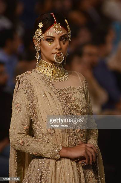 Pakistani models present creations by famous designers on the second day of the Pakistan Fashion Design Council L'Oreal Paris Bridal Week in Lahore