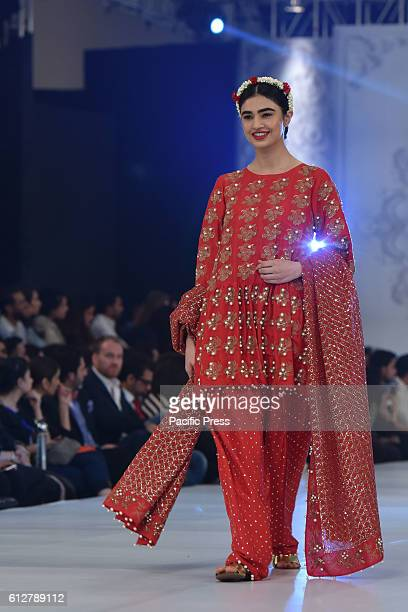 Pakistani models present creations by Pakistani famous designer AliXeeshan during 3rd day of the L'Oreal Bridal Week in Lahore organised by the...